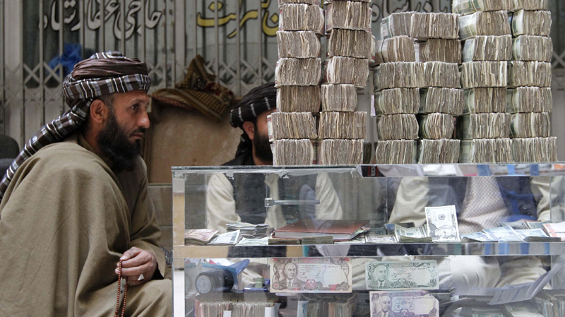 An Afghan dealer waits for customers at a money market in Kandahar province, on Nov. 11, 2012. The U.S. has started attacking the Taliban's funding channels ahead of withdrawing most of its forces by 2014.